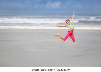Girl jumping on the beach, Rio de Janeiro