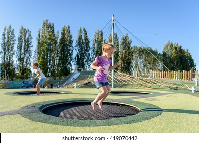 Girl jumping on a trampoline.
