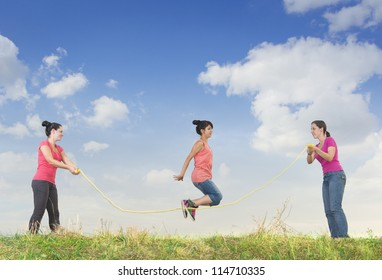 Girl jumping over a rope