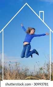 The girl jumps in the field against the sky