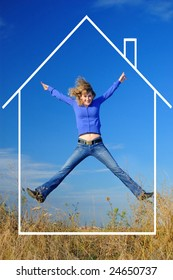 The girl jumps in the field with dreams of the new house