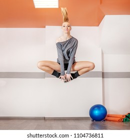 Girl jumps in the gym. Square. The concept of sport, dance and a healthy lifestyle.