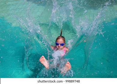 Girl jumps into the water in the pool