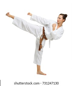 Girl in karate uniform on isolated white background