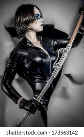 Girl with katana sword. dressed in black latex, comic style