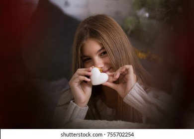 Girl keeping a red heart like a concept for love of Valentine holiday and mother´s day