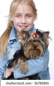 girl keeps terrier