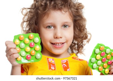 The girl keeps vitamins in packages