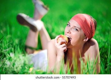 Girl in kerchief with apple
