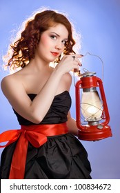 Girl with a kerosene lamp on a blue background