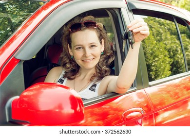 the girl with the keys in the car happy