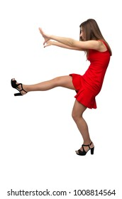 Girl kicks her foot in front of herself and pushes something with her hands or the girl falls or trying to stop something in front of her isolated on white background.