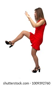 Girl kicks her foot in front of herself and pushes something with her hands or trying to stop something in front of her isolated on white background.