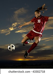 Girl Kicks soccer ball in mid air