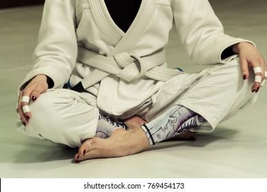A girl in a kimono kneads before training in judo and jujitsu