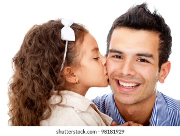 Girl kissing her father - isolated over a white background