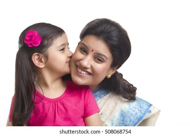 Girl kissing her mother on the cheek