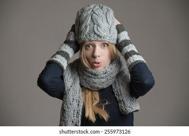 Girl in knitted hat posing in studio