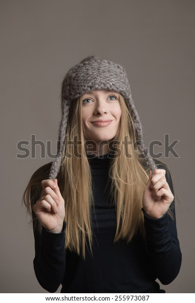 Girl in knitted hat posing in studio