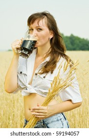 Girl  with kvass at cereals field in summer