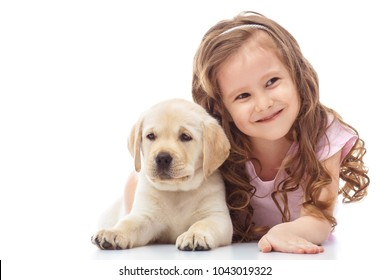Girl with a labrador puppy, isolated on white