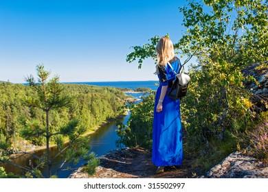 Girl in a landscape in Karelia