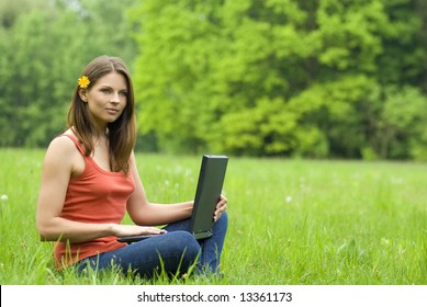 girl with laptop relaxing on the grass, 'free communication'
