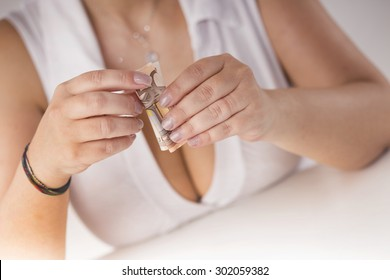 girl with a large breasts plays with banknotes
