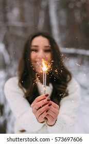 Girl laughing and holding a Sparkler