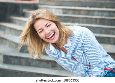 girl laughing on stairs