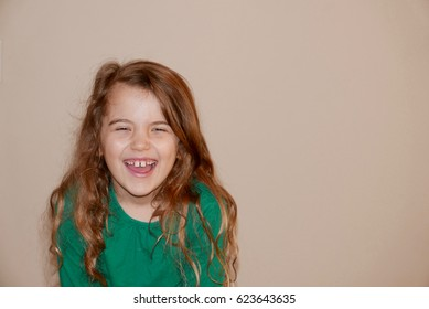 Girl laughing, to the side