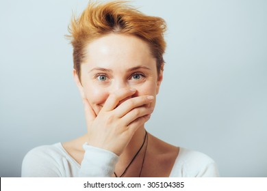 Girl laughs and covers her mouth