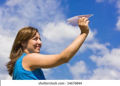 Girl launching  a paper plane