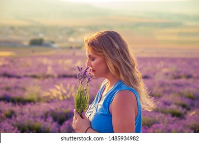 Girl in a lavender field at sunset. Sunny summer evening in Crimea. The concept of happiness and freedom.