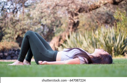 Girl laying down on the park's grass