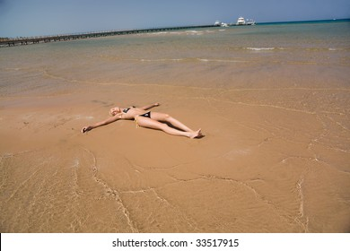 Girl laying on a beach, summer outdoor shot