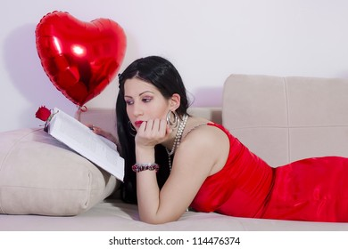 Girl laying on bed reading love stories