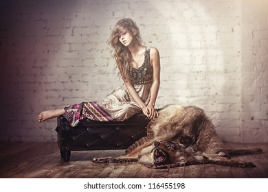 Girl laying on a skin of the wolf