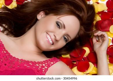 Girl Laying in Rose Petals