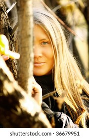 Girl leans the tree on autumn park