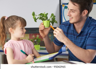 Girl learning about plants with teacher