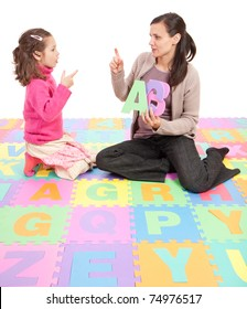 Girl learning phonics alphabet and actions from teacher. Isolated on white
