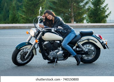 girl in a leather black jacket on motobike
