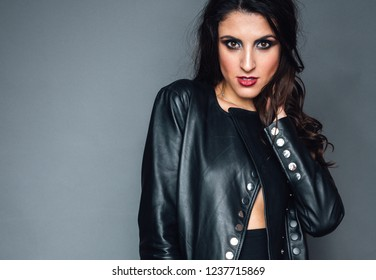 girl in a leather jacket with bright makeup