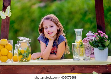 Girl at the lemonade stand is waiting for customers