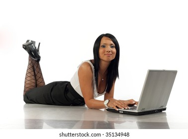 Girl lies with the laptop and smile