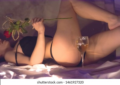 girl lies on bed with vine and rose