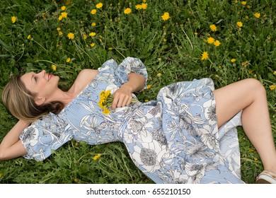Girl lies on the grass