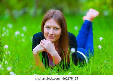 The girl lies on the grass