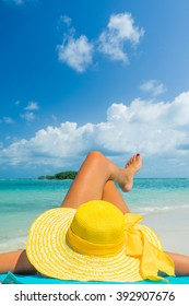 girl lies on the white sand on the tropical  beach